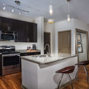 The Bowen apartments in Bowie, MD kitchen with granite countertops, black cabinet and stainless steel appliances