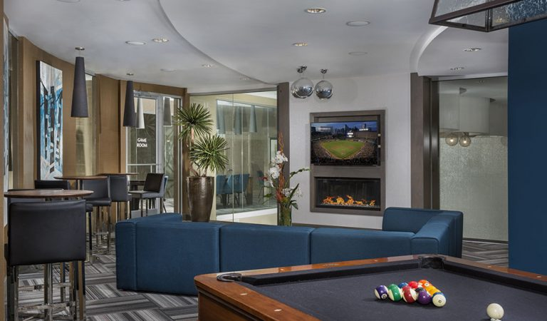 The Bowen apartments in Bowie, MD resident lounge with pool table in foreground and fireplace and tv in background