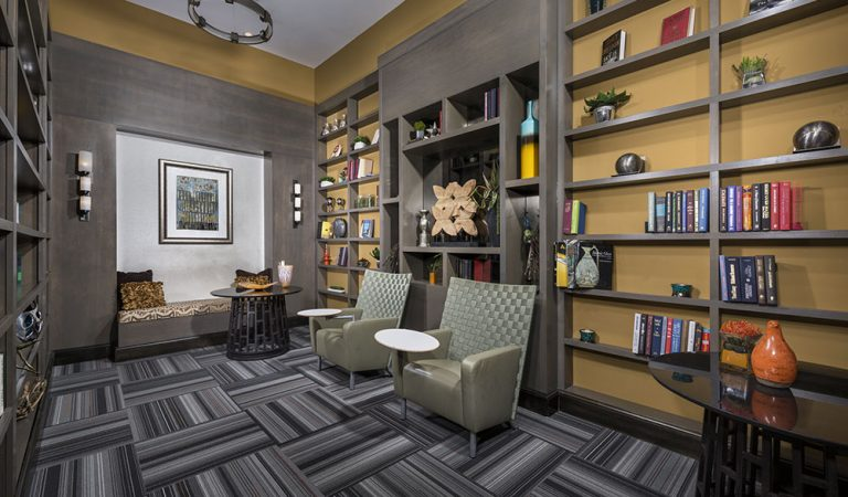 The Bowen apartments in Bowie, MD resident library with bookshelves and leather chairs