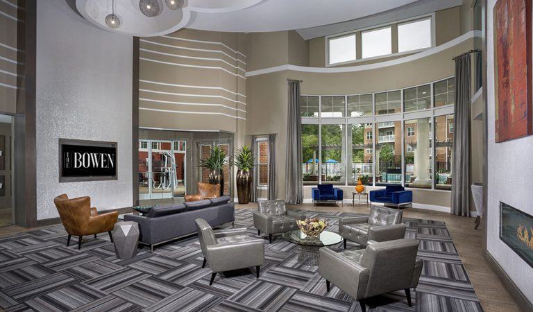 The Bowen apartments in Bowie, MD lobby with seating area and four gray leather chairs
