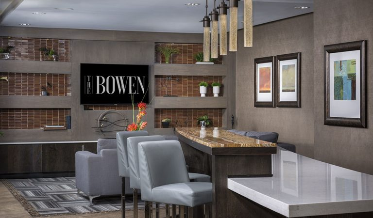 The Bowen apartments in Bowie, MD resident lounge with gray hightop chairs and marble counter