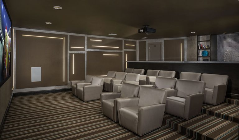 The Bowen apartments in Bowie, MD resident movie theater with big cozy chairs