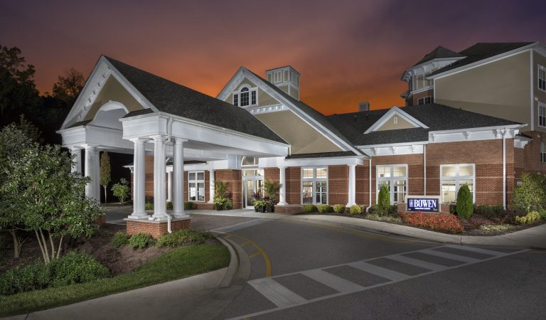 The Bowen apartments in Bowie, MD leasing center exterior at sundown